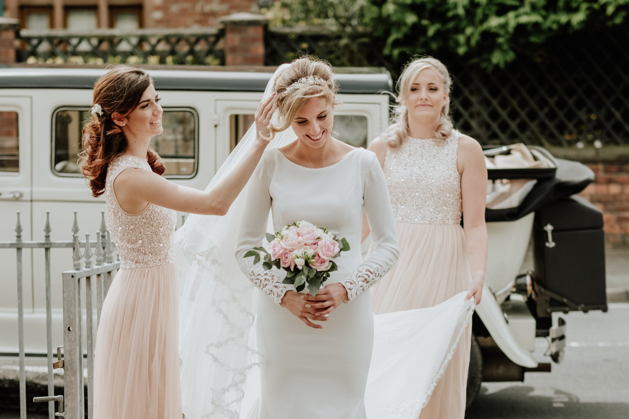 bride arriving at the church with her bridesmaids
