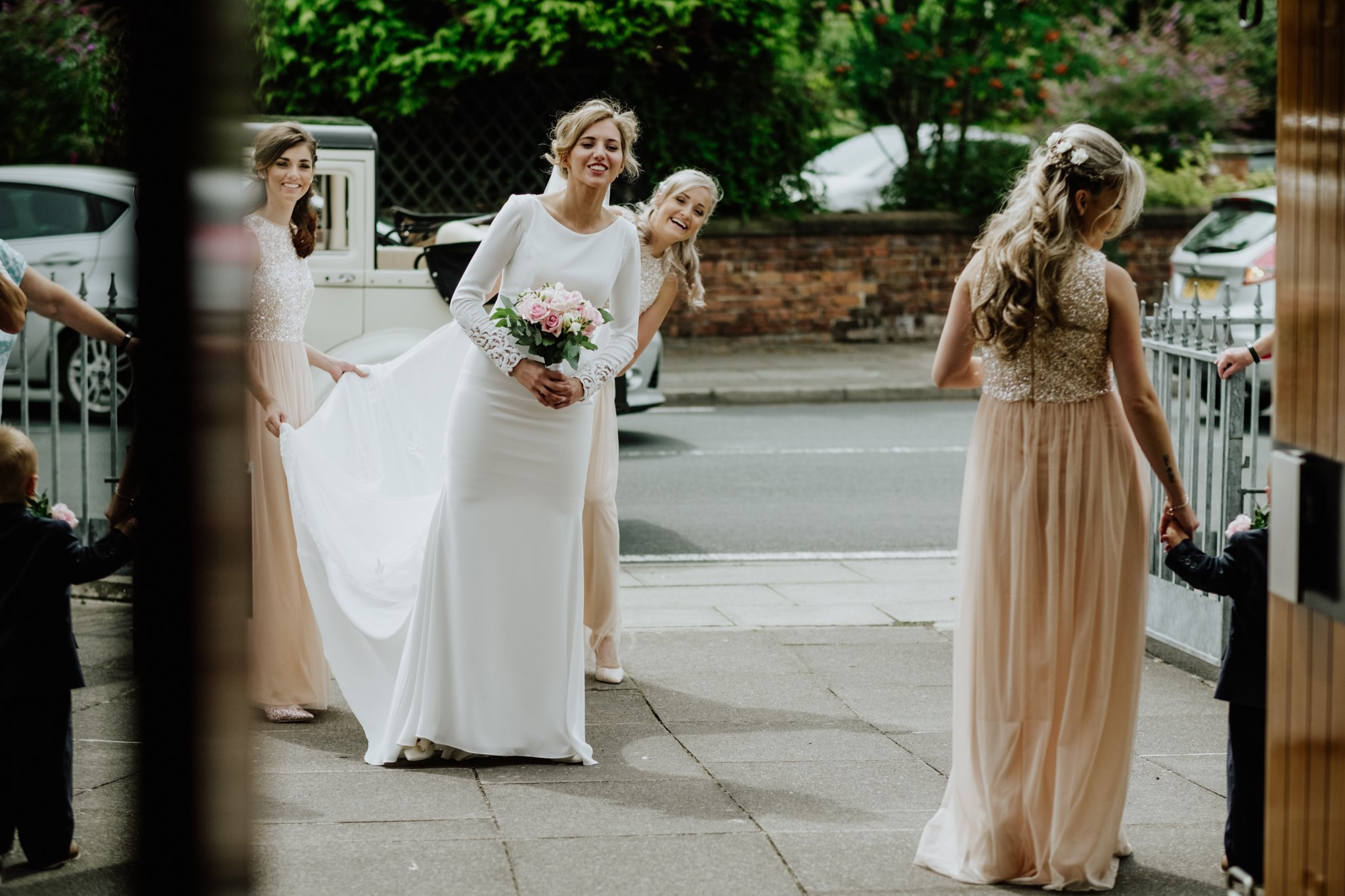 bride and bridesmaids outside the church