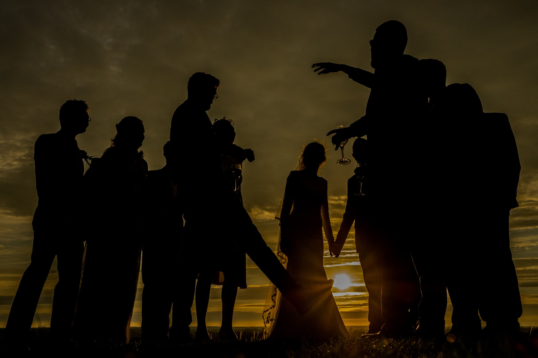 wedding guests sunset silhouette photograph