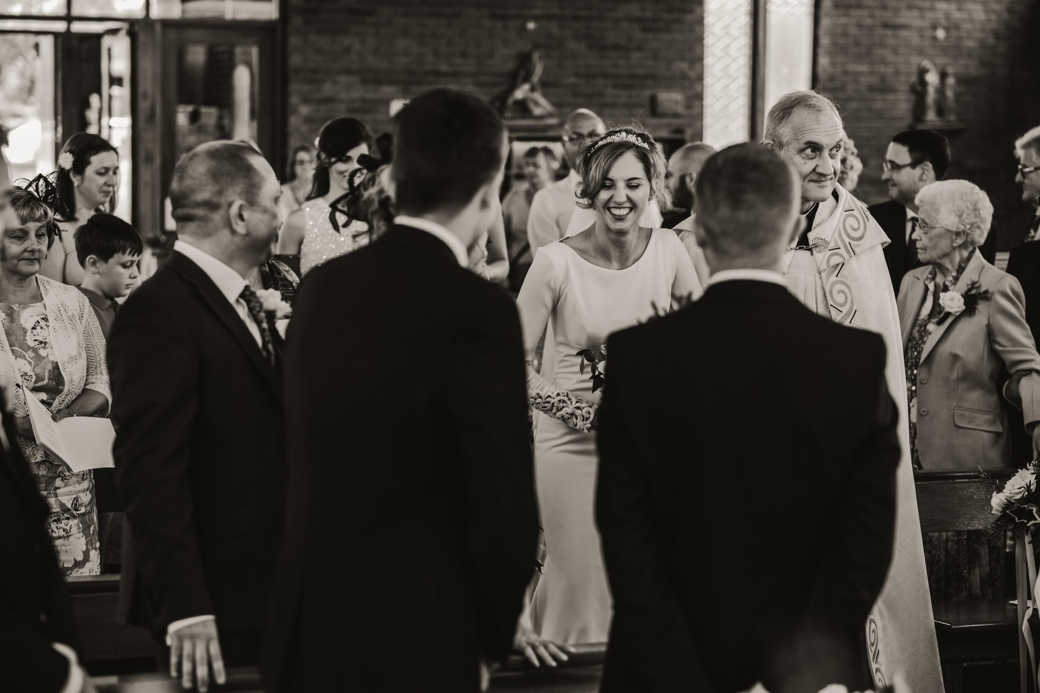 bride walking down the aisle with her dad