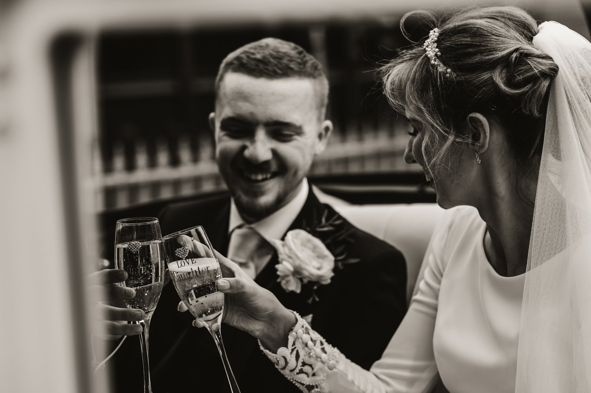 bride and groom enjoying a glass of fizz