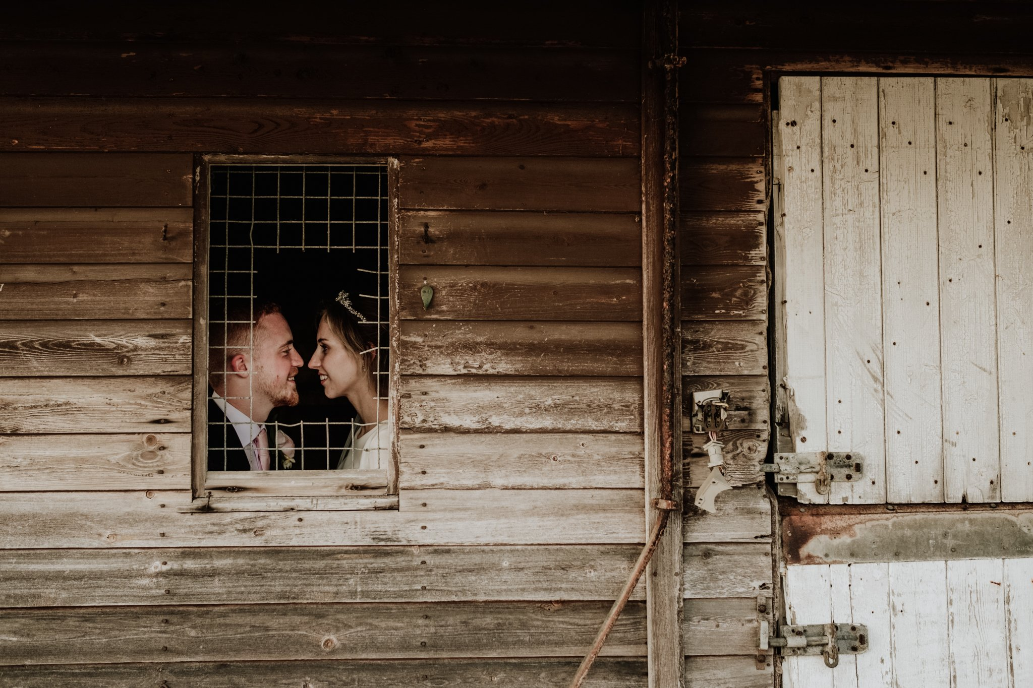 bride and groom portrait photograph at a barn